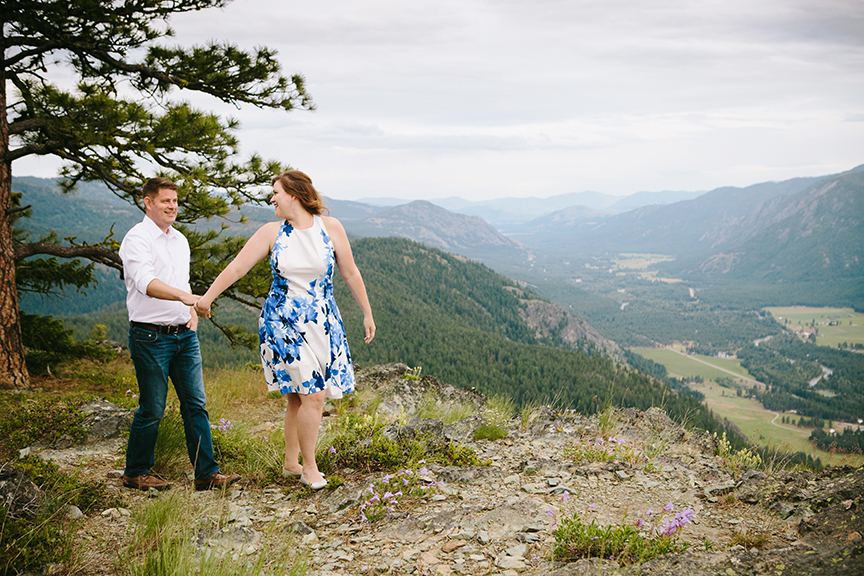 couple holding hand on mountain