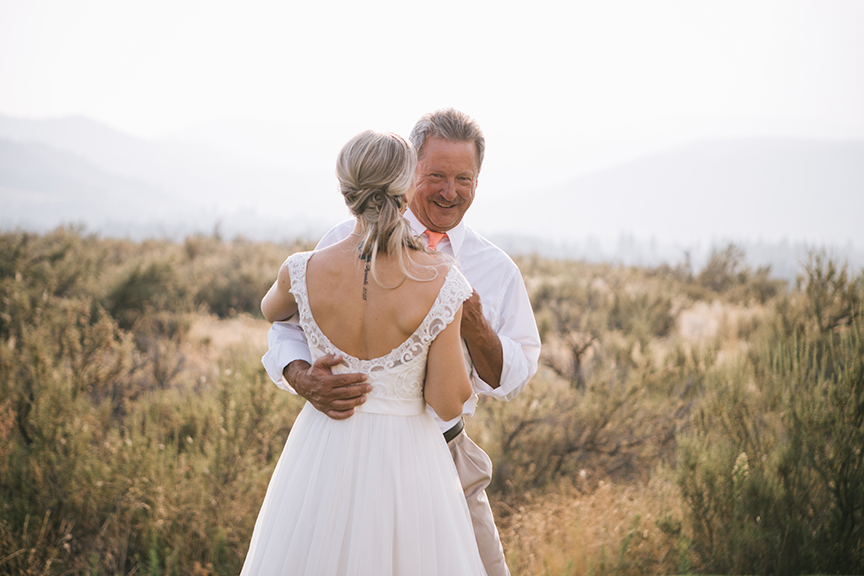 Bride dancing with father laughing backyard wedding