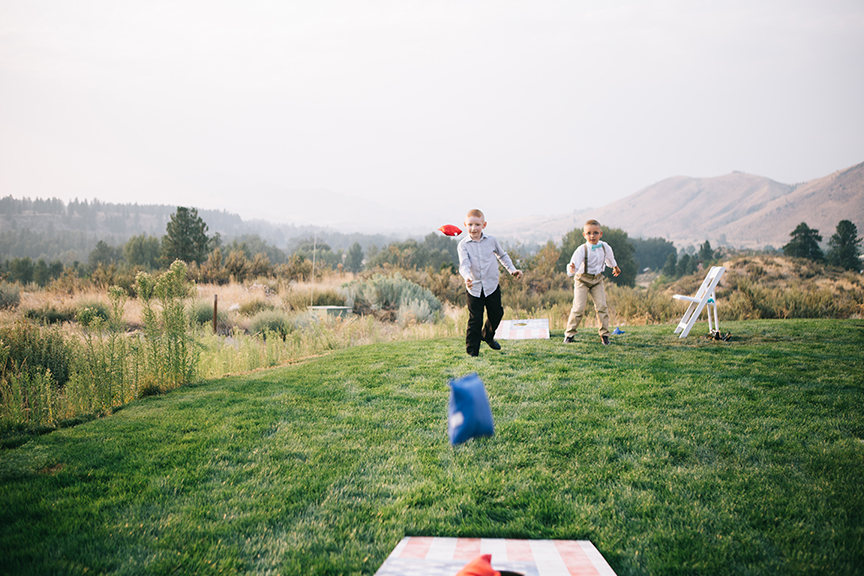 Guests playing lawn games backyard wedding