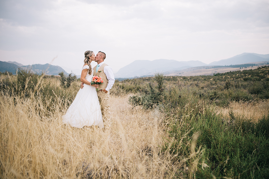 Bride and groom in mountain field summer