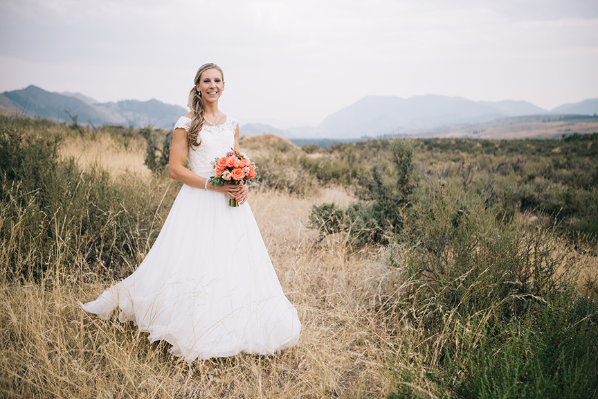 Portrait of bride in a mountain field