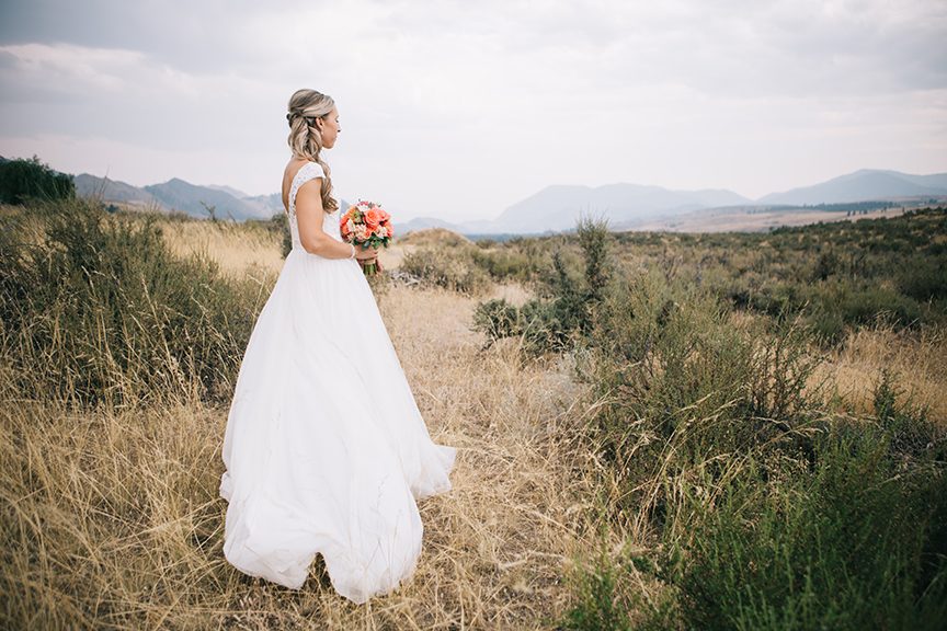 Bride looking away at the mountains