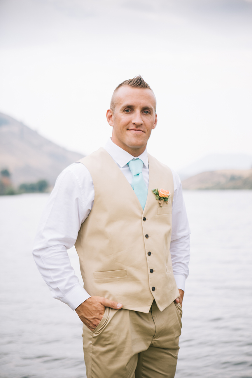 Groom in front of lake