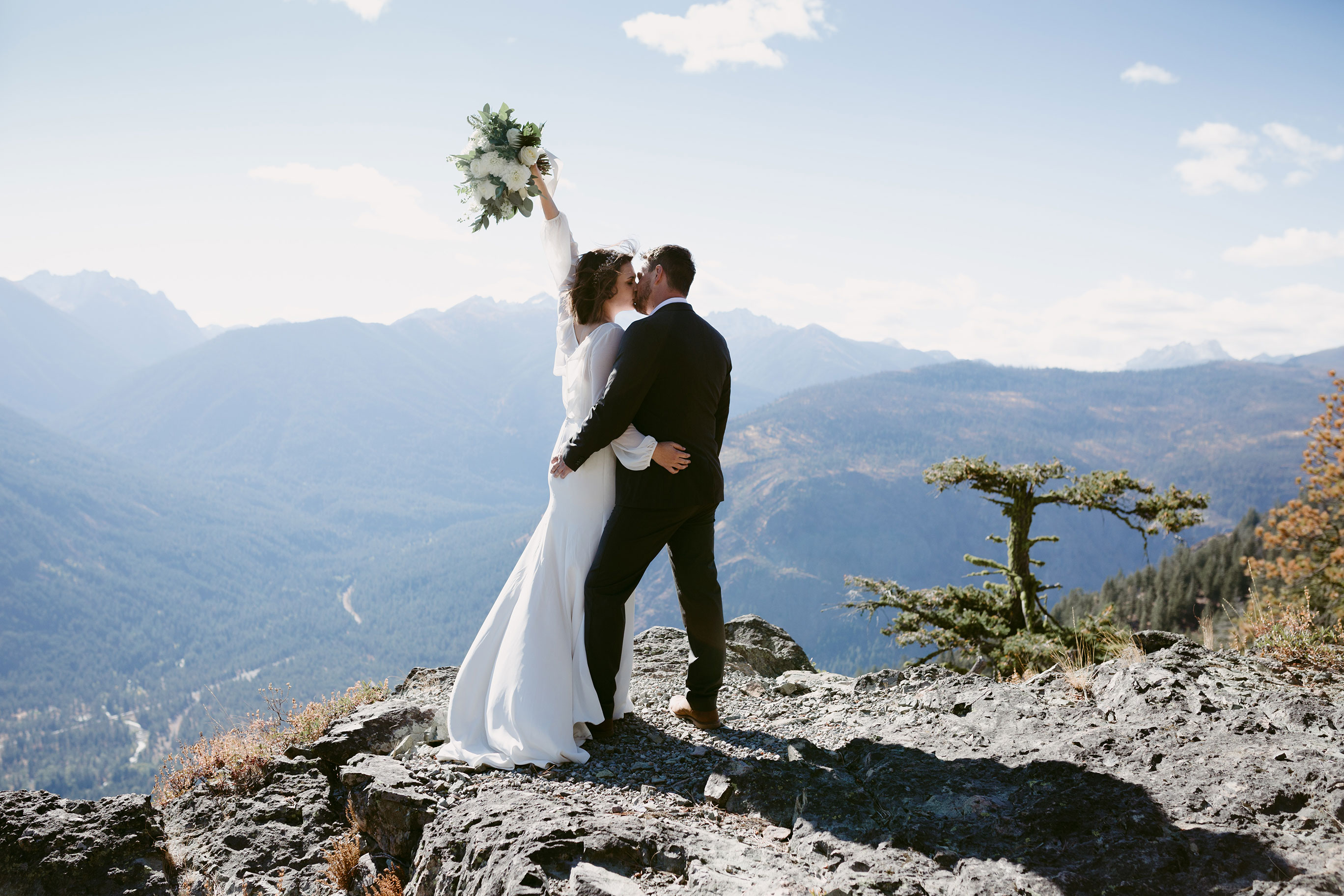 Bride and Groom Portrait on Mountain Cliff Winthrop Wa