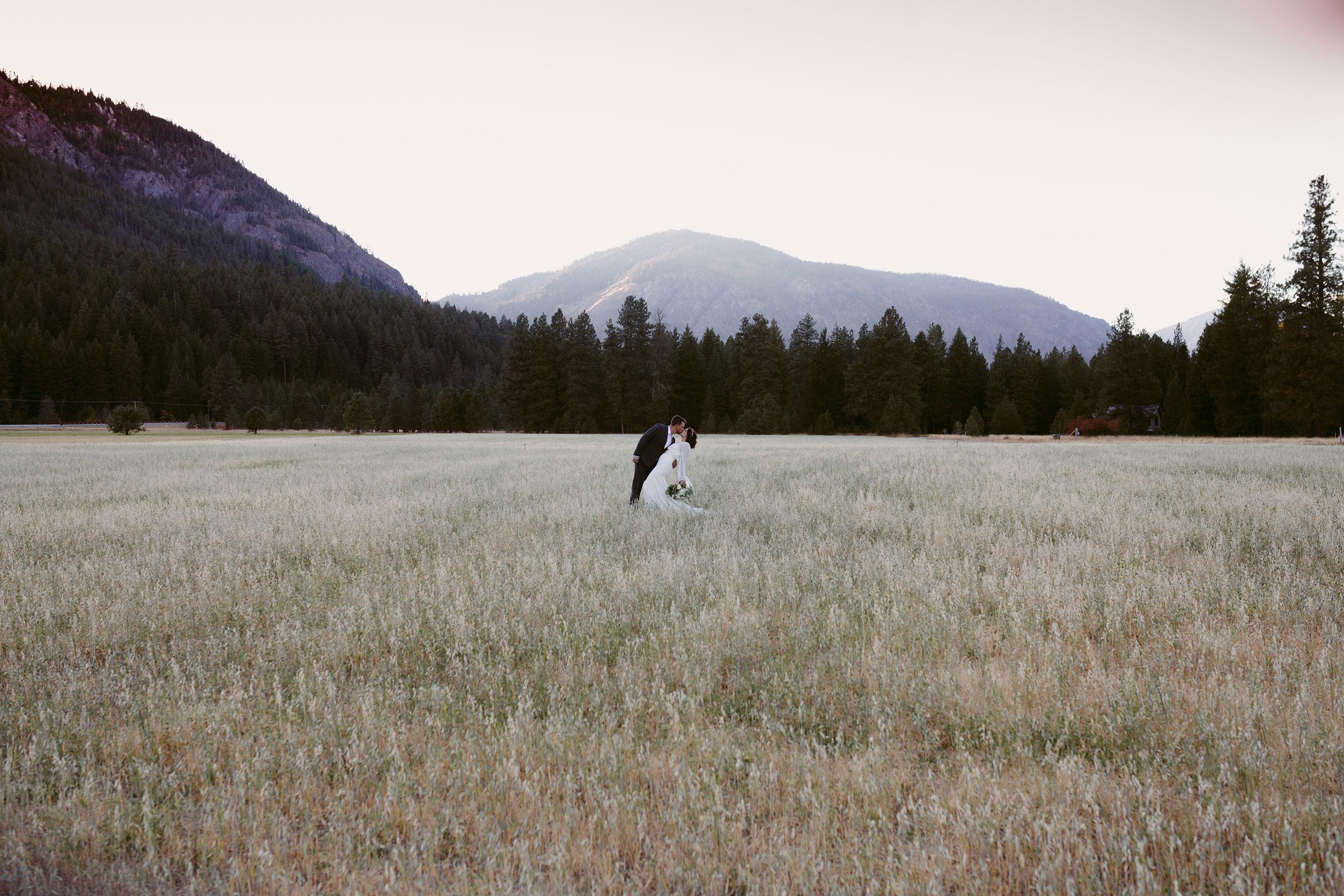 Bride and groom elope in field