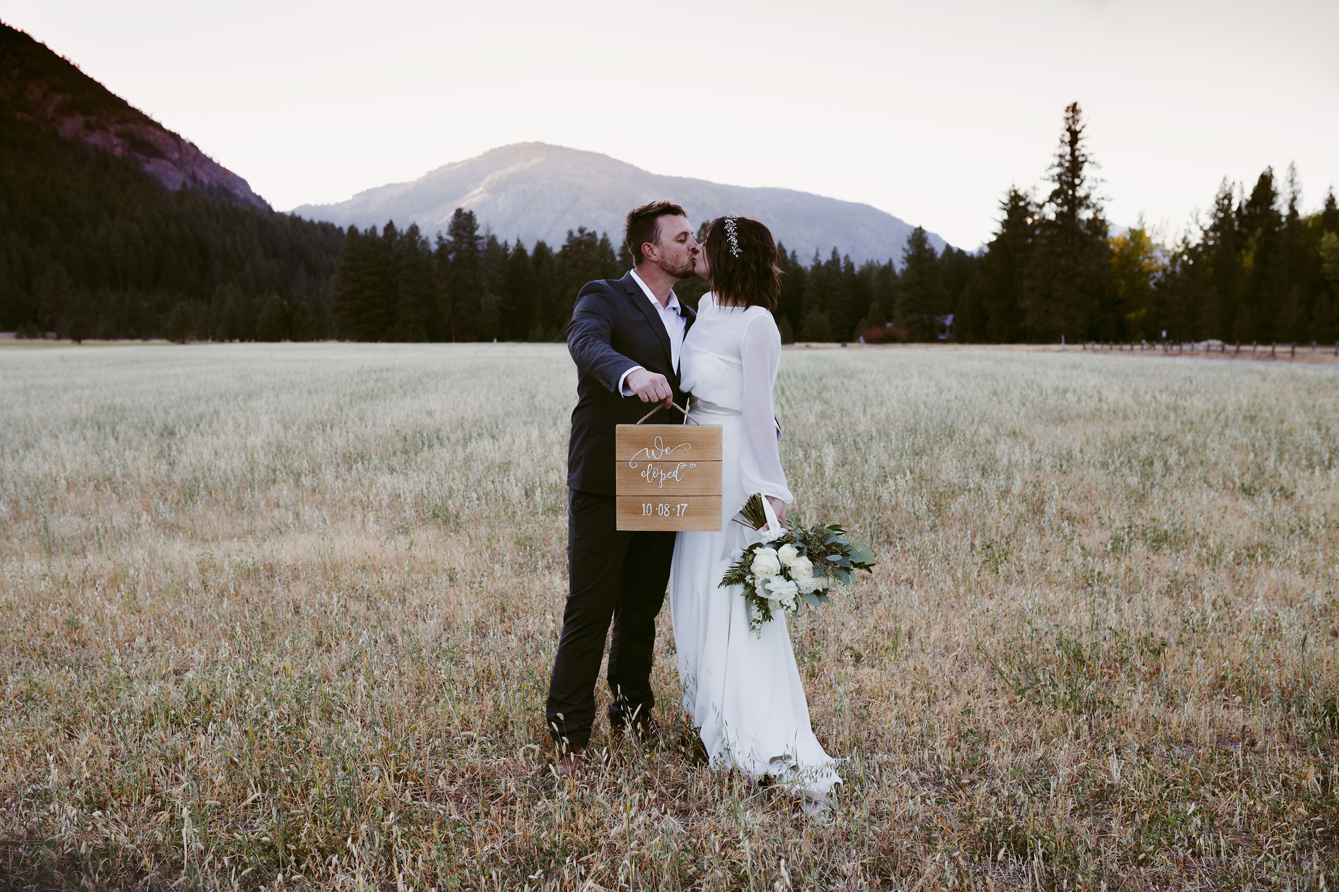Bride and Groom adventure elopement on mountain