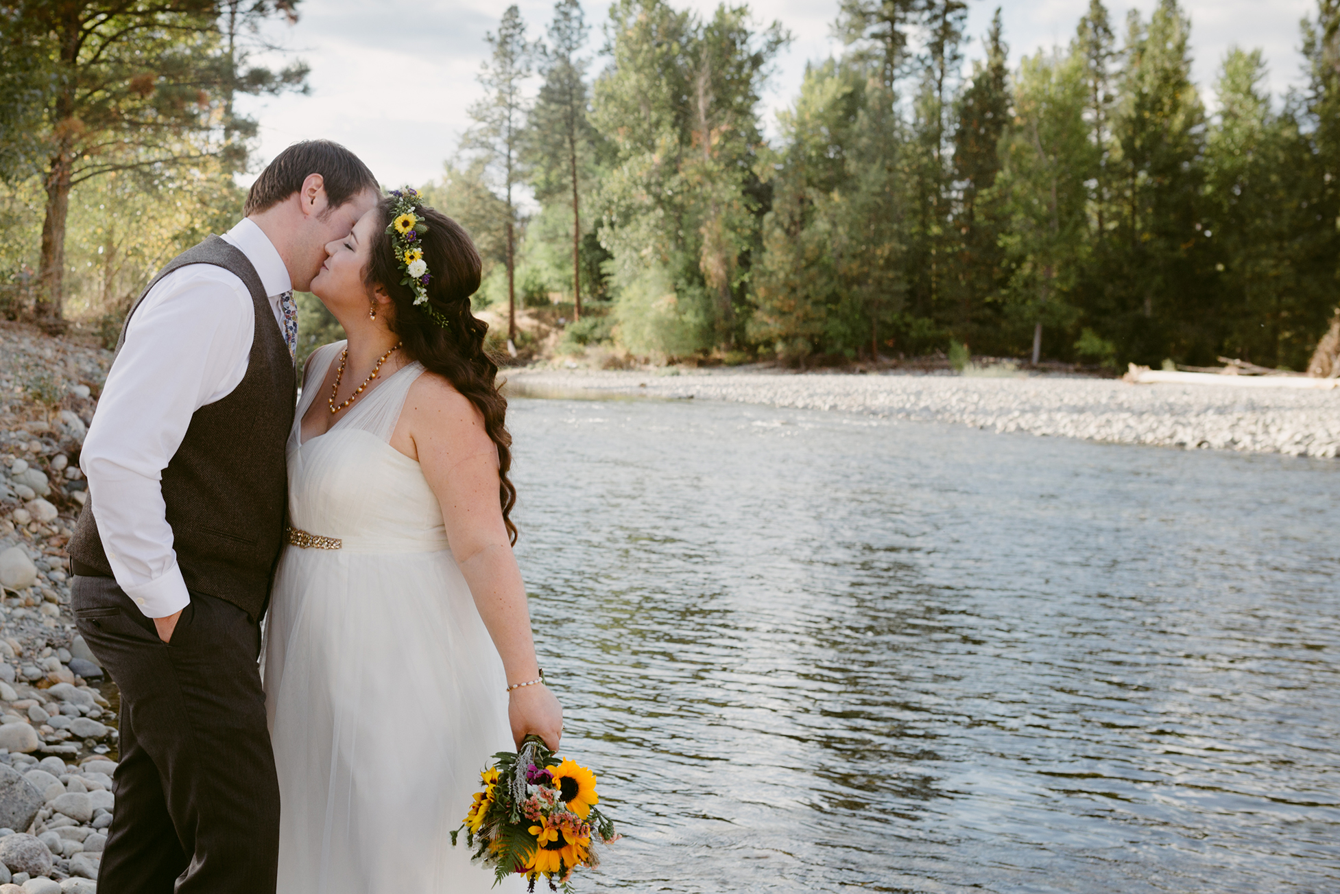 Bride and Groom Kiss at Methow River Spring Creek Ranch