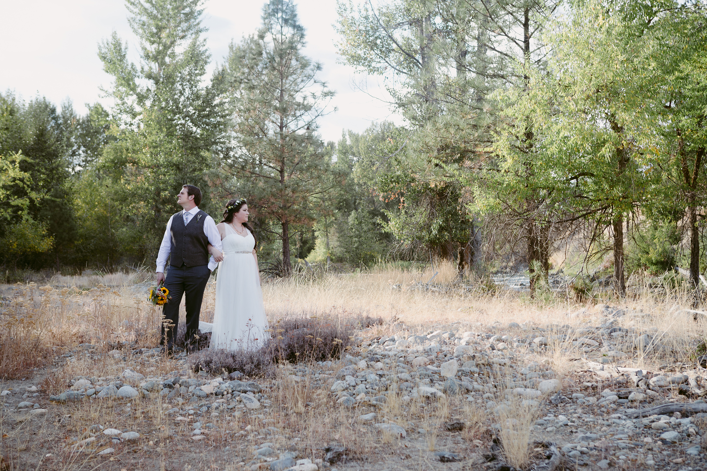 Bride and Groom in forest Spring Creek Ranch Winthrop Wa