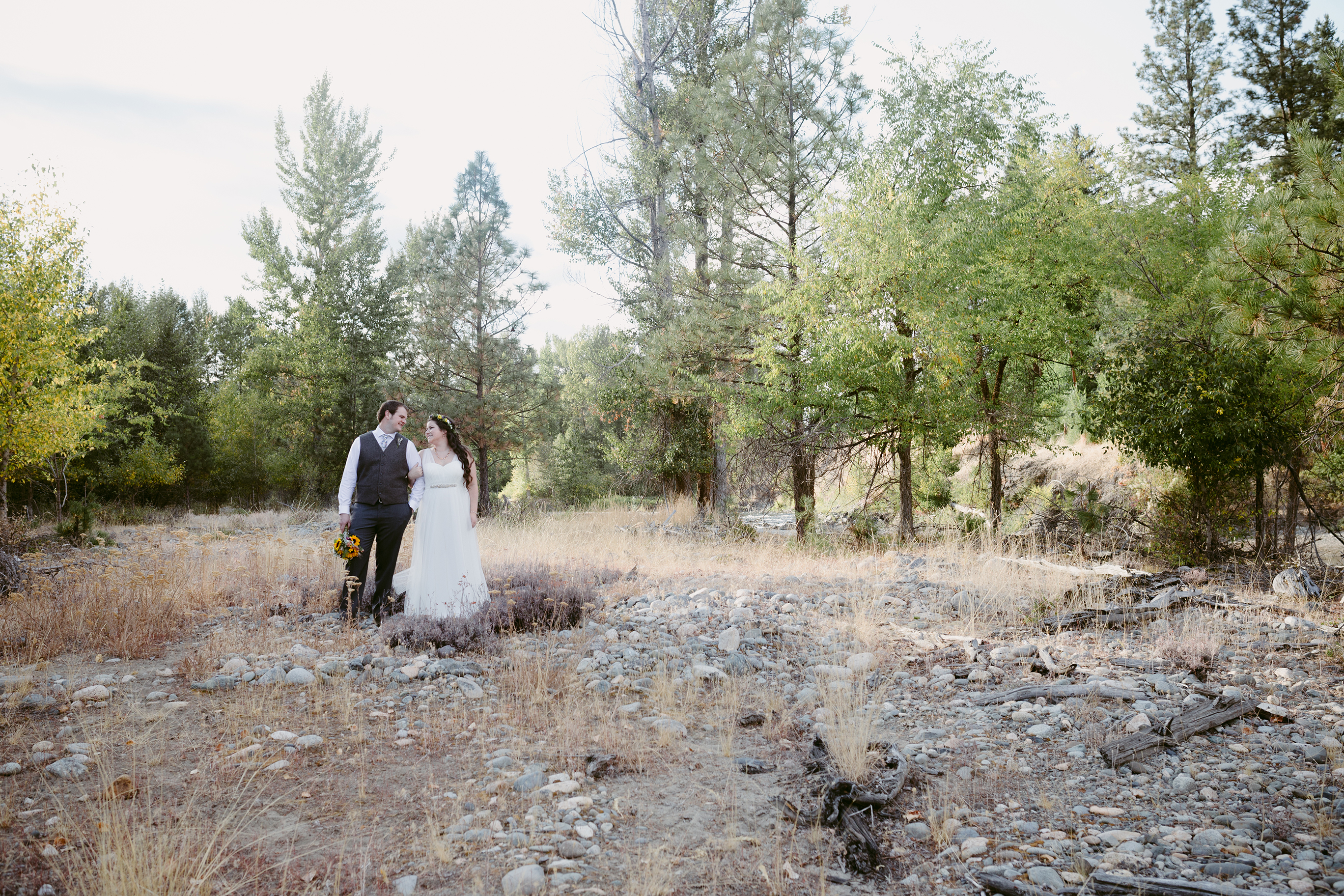 Bride and Groom in forest Spring Creek Ranch Methow Valley
