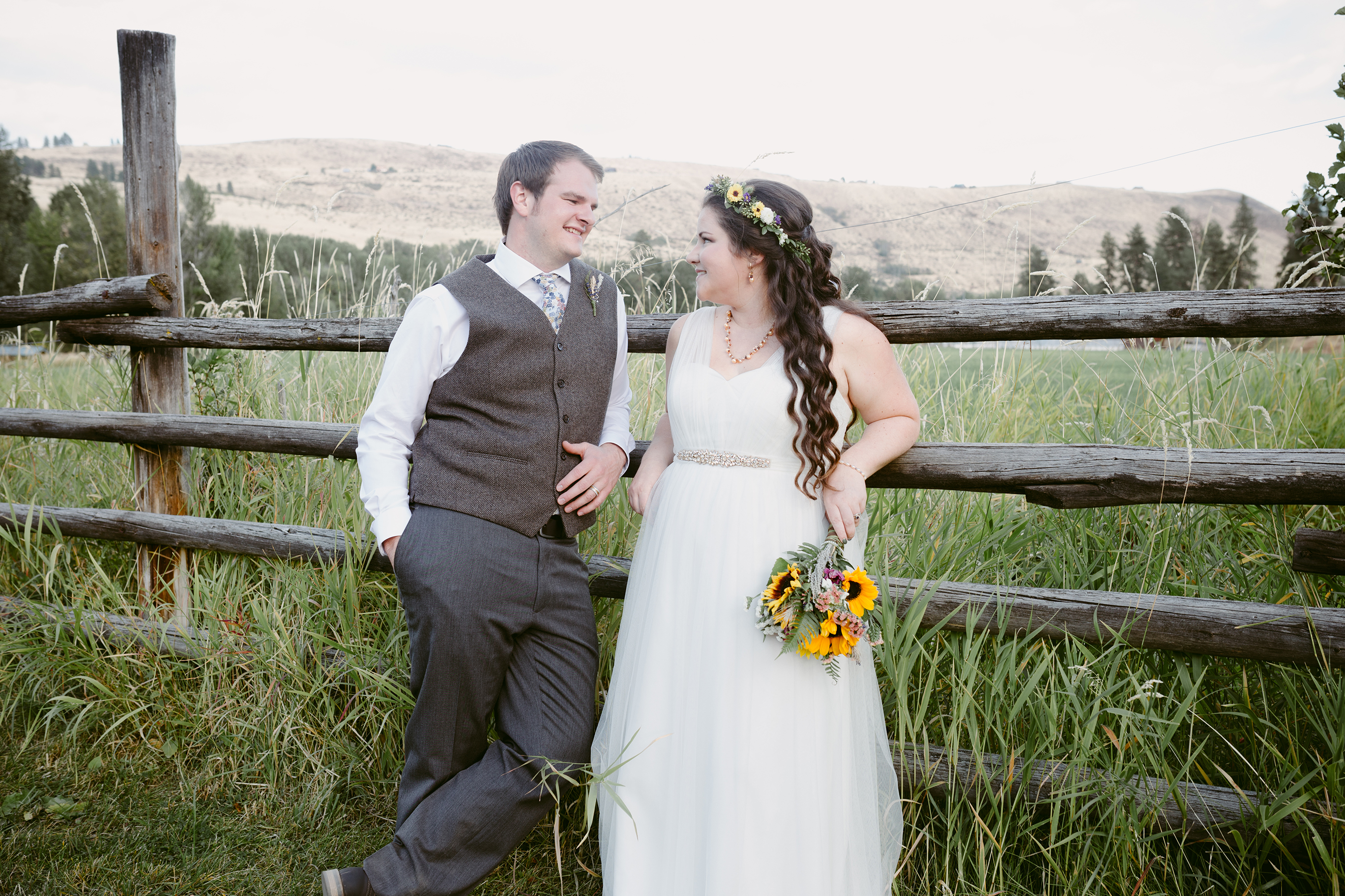 Bride and Groom on Fence Spring Creek Ranch Methow Valley