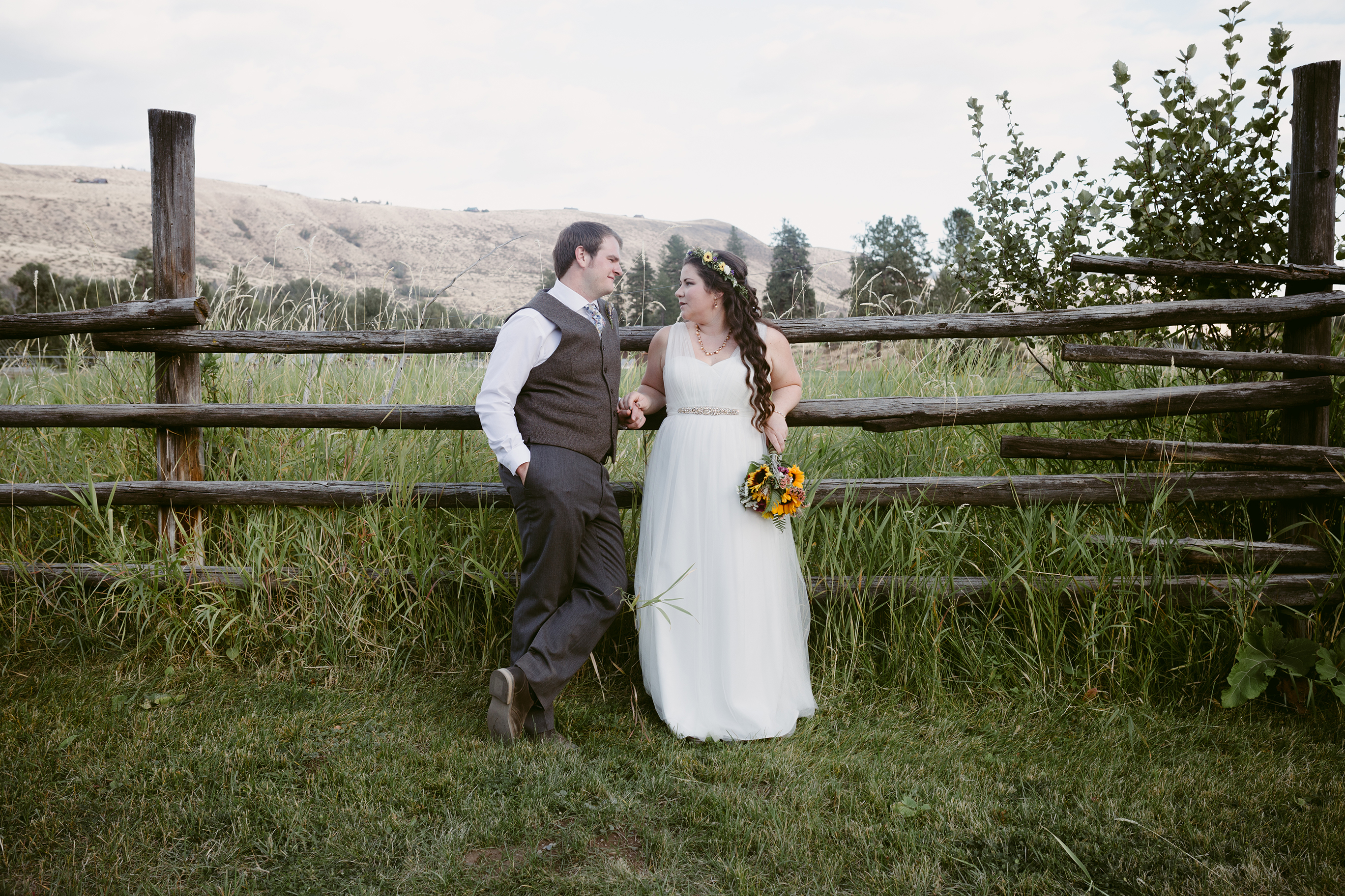 Bride and Groom on Fence Spring Creek Ranch Winthrop Wa