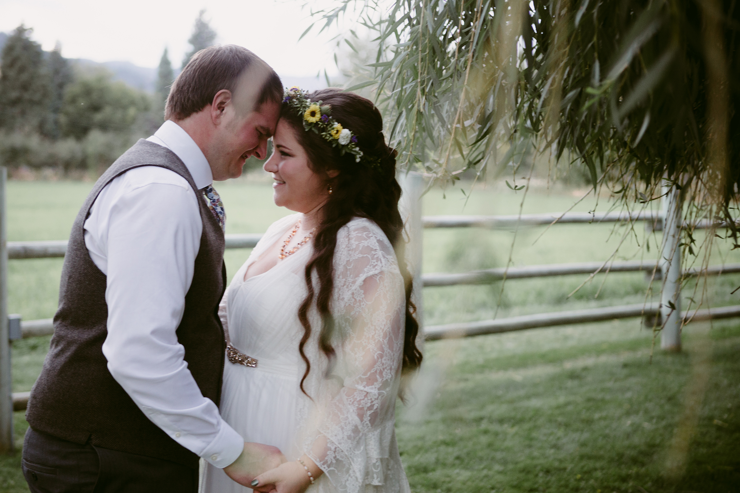 Bride and groom under willow tree Spring Creek Ranch Methow Valley Wa