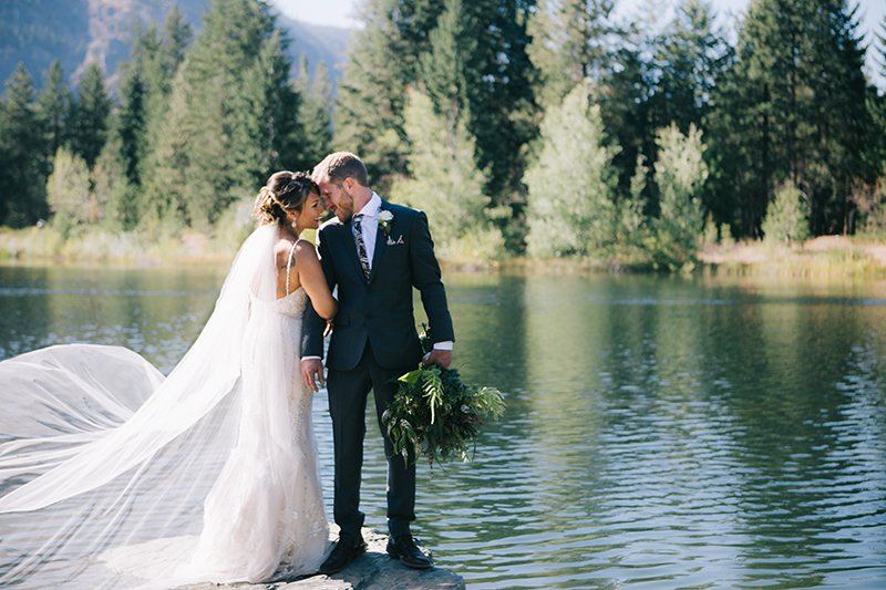 Bride and groom portraits on lake