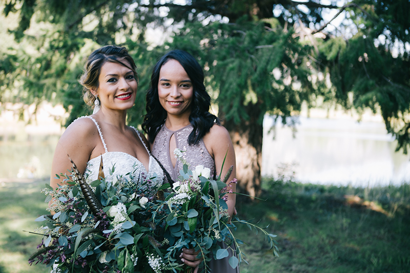 Bride with bridesmaid outdoor wedding