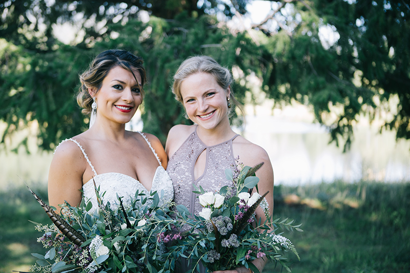 Bride with bridesmaid backyard wedding