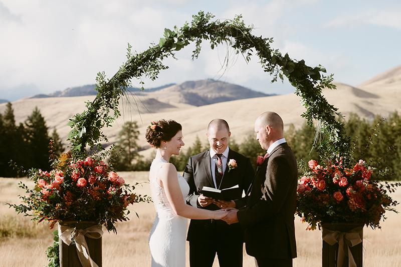 Backyard wedding bride and groom at alter