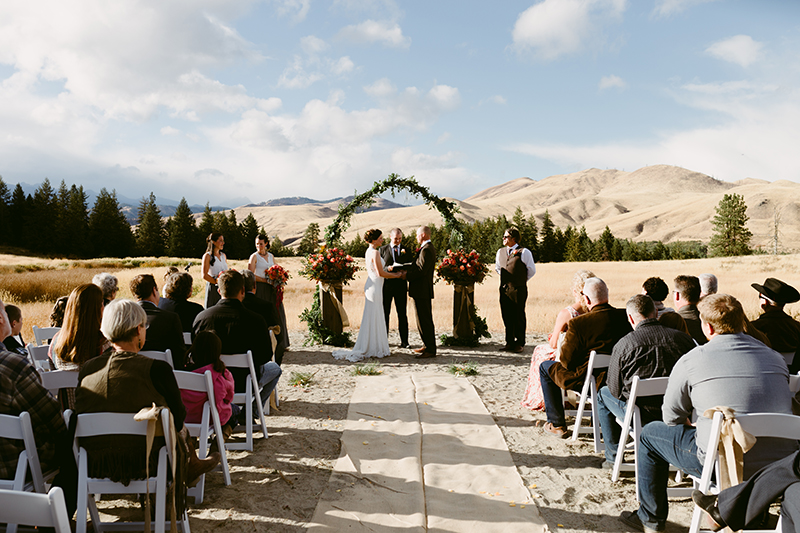 Rustic mountain wedding bride and groom at alter