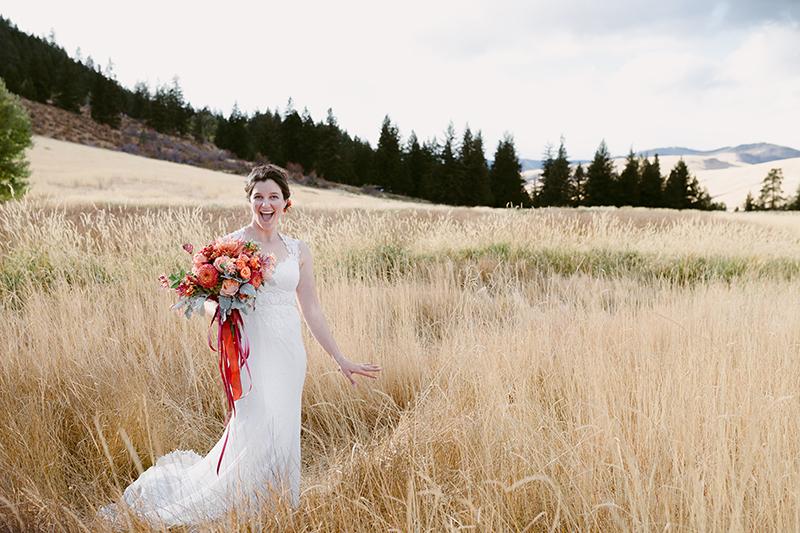 Bride in mountain field