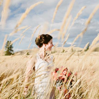 Bride standing in mountain meadow winthrop wa