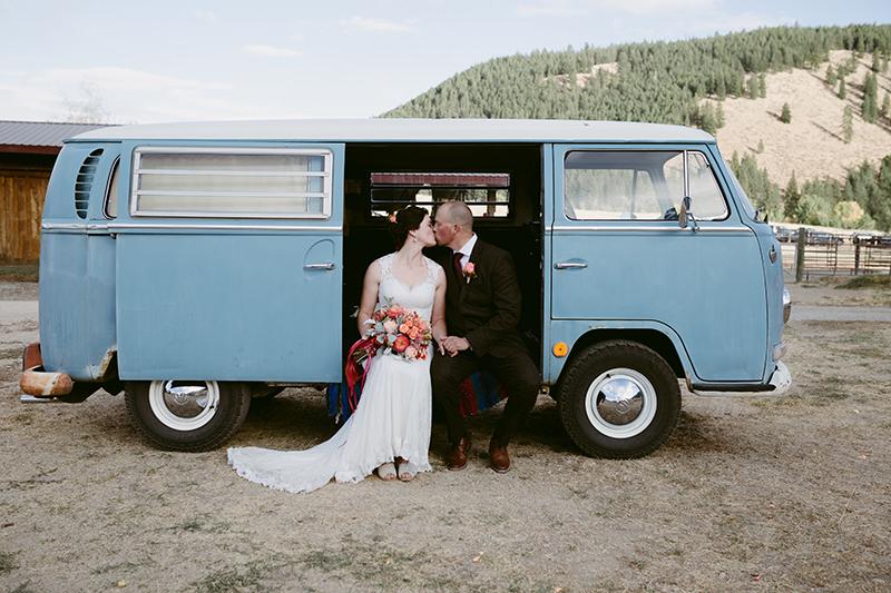 Bride and groom in blue volkswagon van